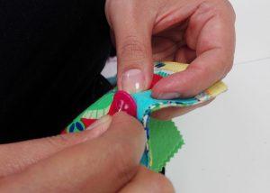 aprende a coser un boton