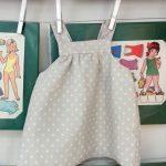 Pichi de lunares blancos sobre tela gris, curso de ropa para bebe y niños-as